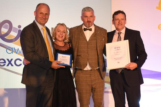 Local publicans Phil Hoyle and fiancée Sarah receiving their award with Ei Group's executive Simon Townsend           Picture by Mark Eaton