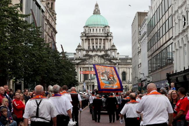 Bandsmen and Orange Order members take part in an Orange Order parade in Belfast