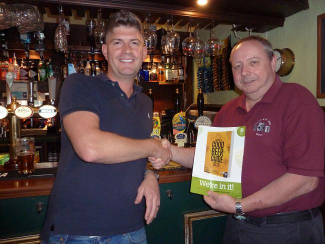 Ian Turner (right), chairman of the Salisbury & South Wilts branch of the Campaign for Real Ale (CAMRA), presenting Dave Hancock, landlord of Deacons, with his Good Beer Guide certificate.