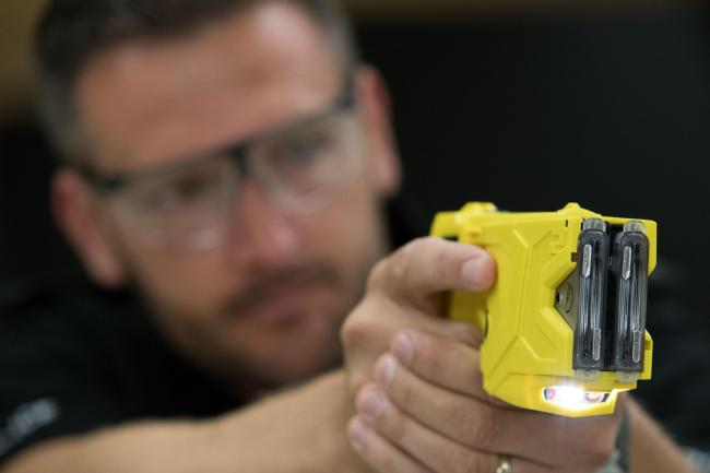 File photo dated 7/8/2017 of a taser being demonstrated. More than eight out of 10 police officers want to carry stun guns such as Tasers and would feel safer with the devices, a new poll suggests..