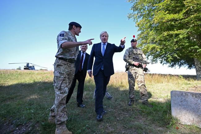 Prime Minister Boris Johnson and Defence Secretary Ben Wallace meet with military personnel on Salisbury Plain training area near Salisbury.  PA Photo. Picture date: Thursday September 19, 2019. Photo credit should read: Ben Stansall/PA Wire.