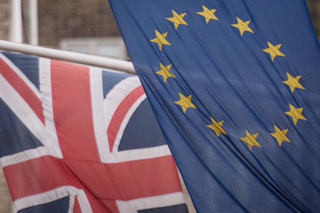 File photo dated 17/2/2016 of the EU and Union flags. More than 100 Westminster constituencies which backed Leave in the 2016 referendum would now vote to remain in the European Union, according to new analysis of polling..