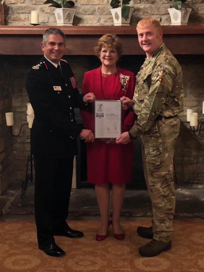 Dorset & Wiltshire Fire and Rescue Service (DWFRS) has received the Defence Employer Recognition Scheme silver award. Pictured is Chief Fire Officer Ben Ansell with the Lord Lieutenant of Wiltshire, Sarah Troughton, and Army reservist Dean Hoskins, wh