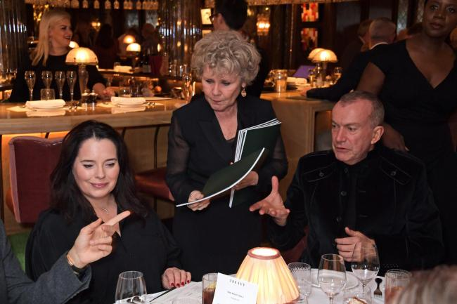 Imelda Staunton serves guests during One Night Only at The Ivy in aid of Acting For Others
