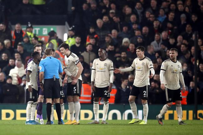 Manchester United have been fined for surrounding referee Craig Pawson