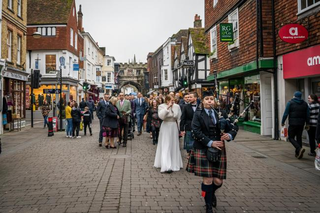 The wedding procession was led through the streets of Salisbury by a bagpiper 			Picture: Ben Lee