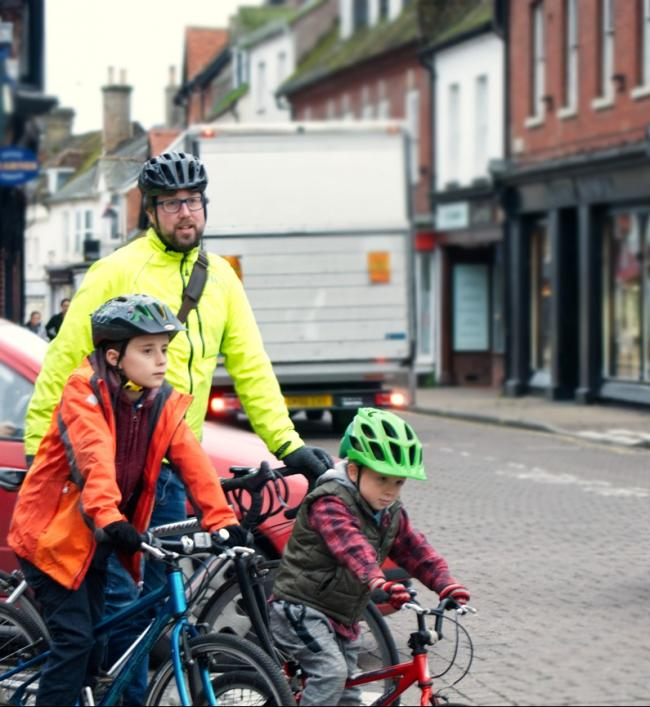 Joe Moorhouse and his children negotiating Ringwood's busy roads on their bikes