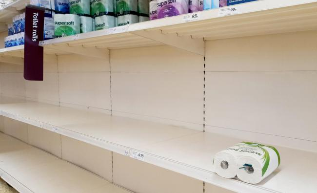 A view of empty shelves as toilet roll is almost sold out in a supermarket 