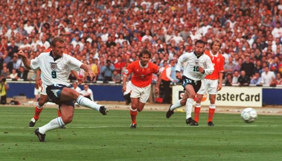 Alan Shearer scores from a penalty to open the scoring for England in tonight's Euro 96 clash against Holland at Wembley. Picture: Neil Munns/PA