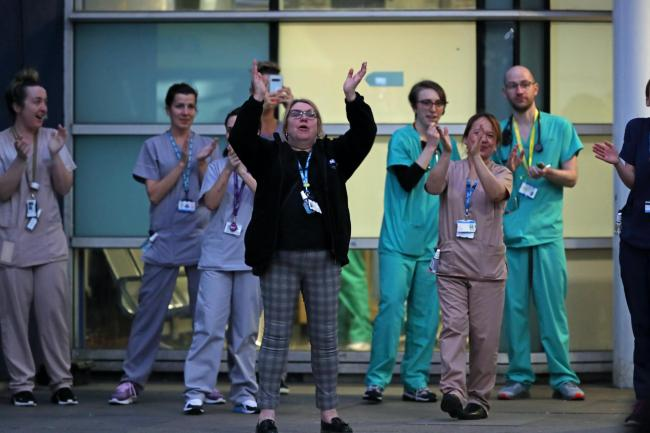 Staff from the Royal Liverpool University Hospital join in the national applause