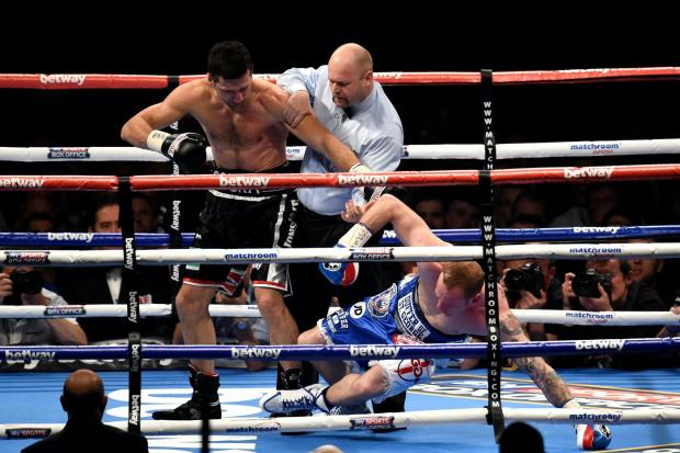 Carl Froch knocks down George Groves