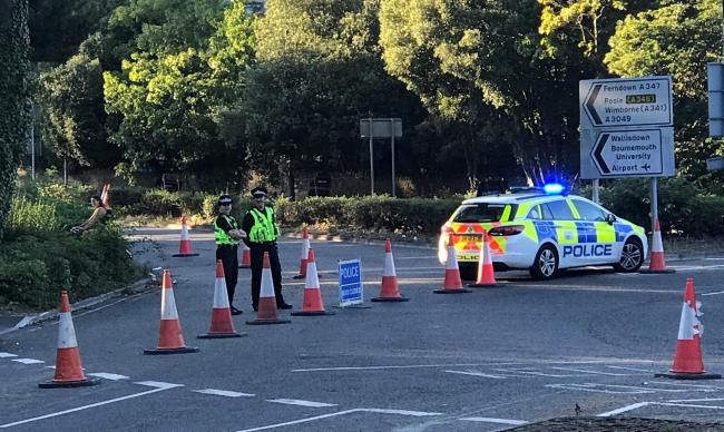 Emergency services rushed to the scene of the collision in Wallisdown Road