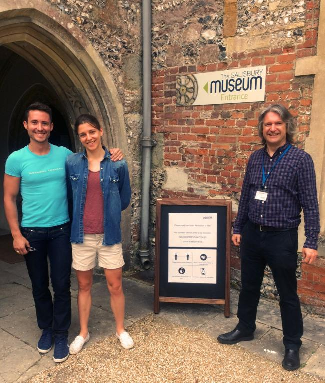 Salisbury Museum director Adrian Green welcomes the first visitors to the newly reopened museum