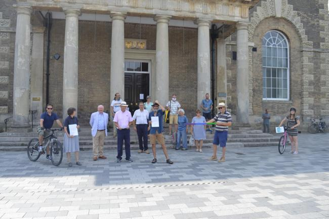 A letter of support for the pedestrianisation plans has been handed to the leader of Salisbury City Council, Jeremy Nettle, on the steps of Salisbury Guildhall
