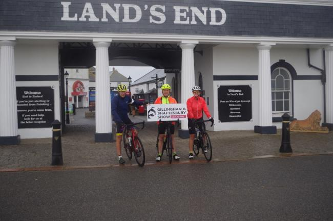 Rob Gale, Anthony Wilkinson and Julie Hiller at Land's End ready to set off on their journey