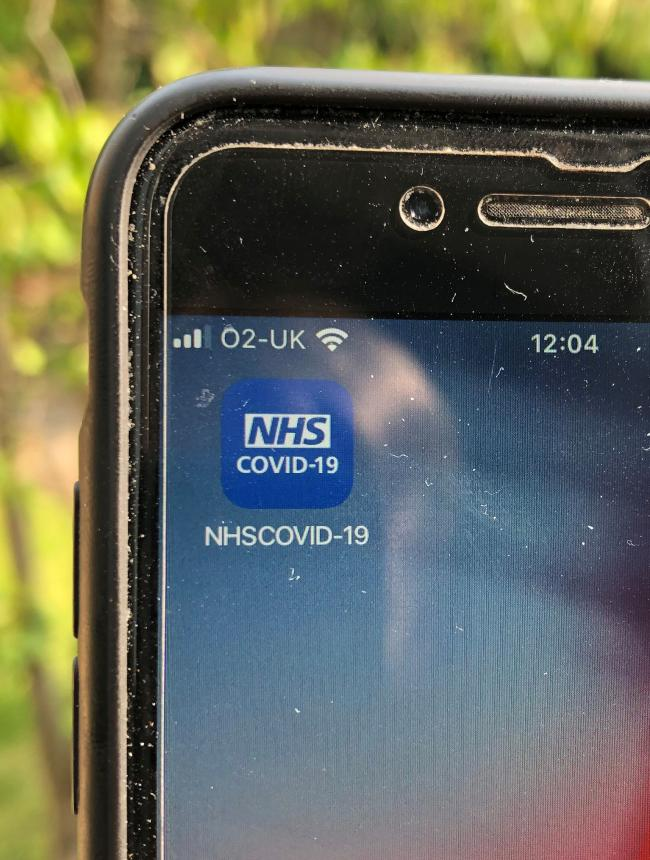 The NHS Covid-19 app on a mobile phone. The app is to be launched across England and Wales within two weeks, with pubs, restaurants and other businesses urged to have codes ready for customers to check in when they visit. PA Photo. Picture date: Friday Se