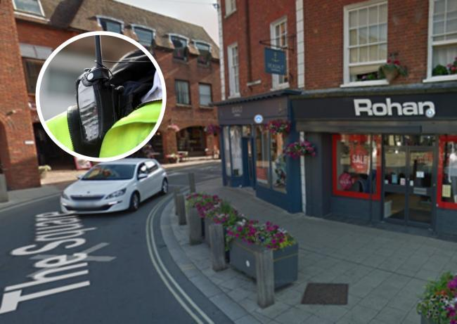 Man verbally abused and punched during assault outside shop