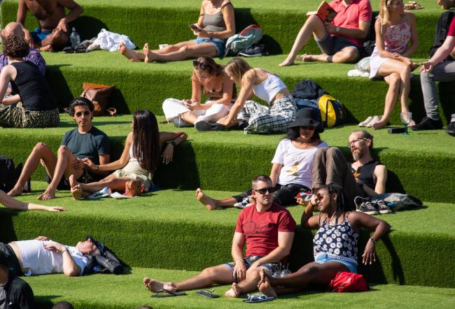 "People enjoying the Autumn sunshine in Kings Cross, London. The public has been urged to act ""in tune"" with Covid-19 guidelines before the ""rule of six"" restrictions come into force on Monday.  PA Photo. Picture date: Sunday"