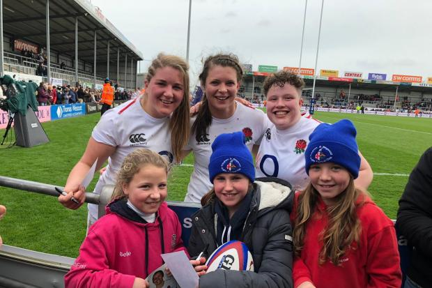 Former Ellingham and Ringwood player Poppy Cleall with her England team mates Abbie Ward and Hannah Botterman meeting current Ellingham and Ringwood girl's players Bella Johnson, Kitty Taylor and Ellie Johnson.