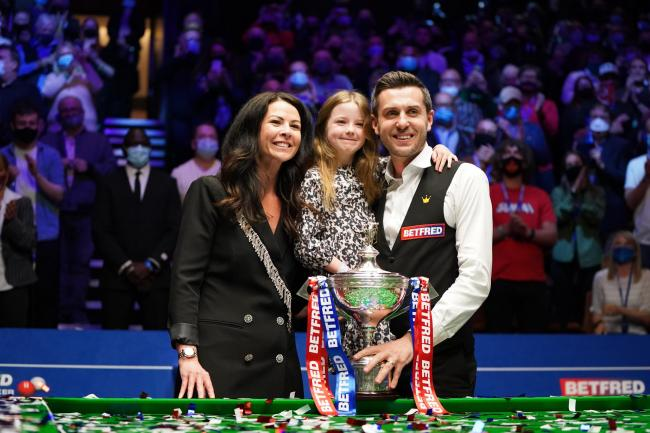 Mark Selby celebrates with his wife and daughter after winning the world title for a fourth time