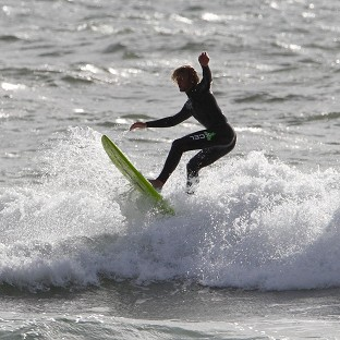 A surfer has died after getting into difficulties off the coast of Suffolk, police said