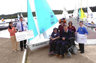 Winner of the name the boat competition Anthea Green, Manager of Sainburys Simon Church, Chairman of Sailability Eric Blyth, Disabled Yachtsman and Geoff Holt with NFDS Sailor Liam Foy. To see more pictures from this event, click Buy this photo..