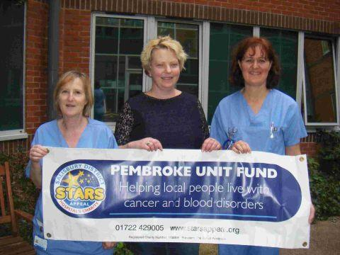 Jenny Hunt hands over a cheque to the Stars Appeal