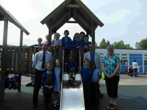 Verwood's Methodist minister Nigel Deller, heaadteacher Roger Withey and PTFA chairman Lynne Arnold open the new play equipment with the chi