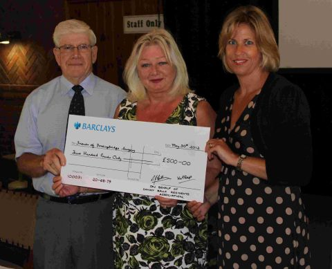 Sandy Balls Residents' Association chairman Keith Phillips presents a cheque to Jackie Lydford, centre, and Michelle Raymond.