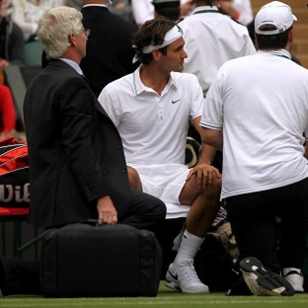 Roger Federer (centre) took a medical time-out during the opening set