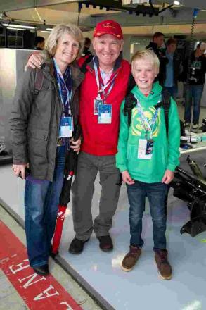 Samuel Cheetham with his parents in the Mercedes garage at the Grand Prix.