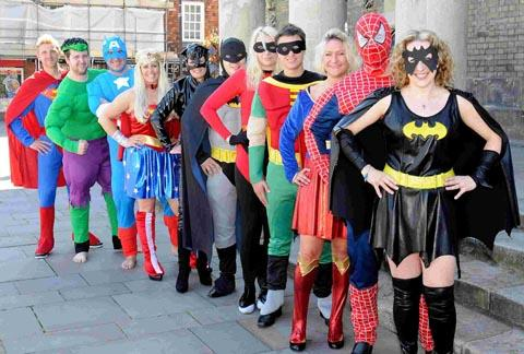 Staff from the Salisbury Journal and Spire FM dress as superheroes to launch this year's awards. DC1918P3