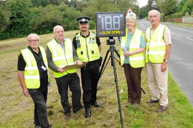 PC Russell Skinner with members of the Community Speed Watch at Sandleheath