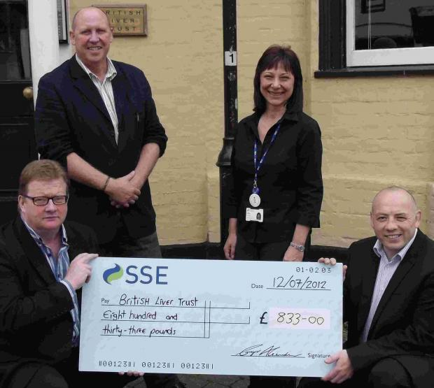 Bottom left, British Liver Trust chief executive Andrew Langford, top left, Gary Pulman, with Linda Spray and Ian Reynolds of SSE Contracting.
