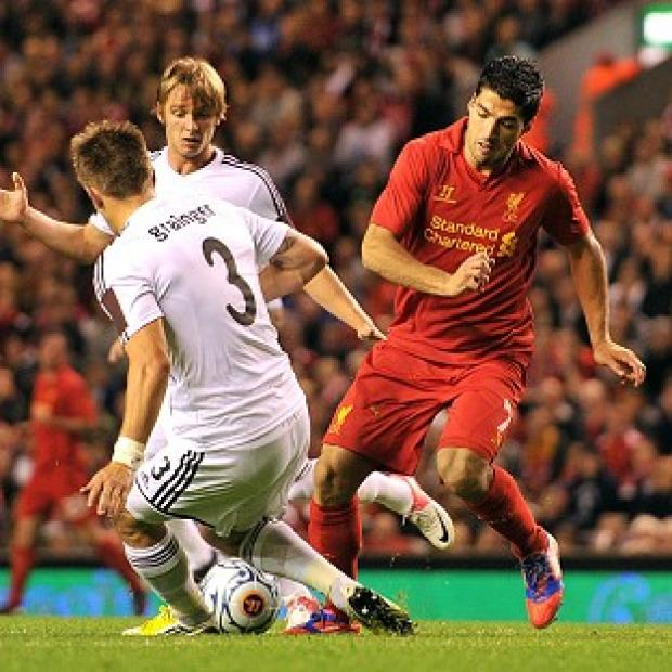 Salisbury Journal: Luis Suarez, right, scored a late goal to settle the tie in Liverpool's favour