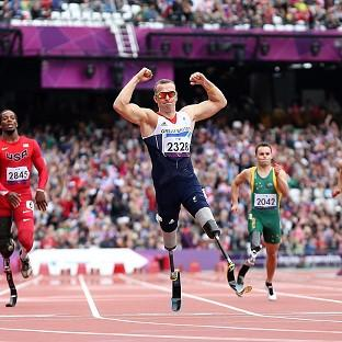 Richard Whitehead claimed gold and a new world record over 200 metres at the Olympic Stadium