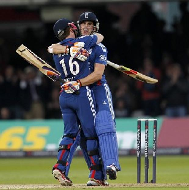 Eoin Morgan and Craig Kieswetter embraec after guiding England to victory over South Africa.