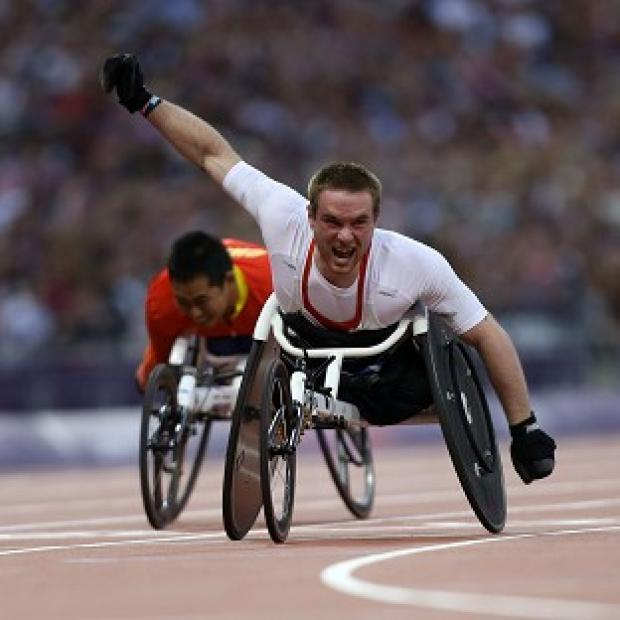 Mickey Bushell pulled clear to win gold in the T53 100 metres