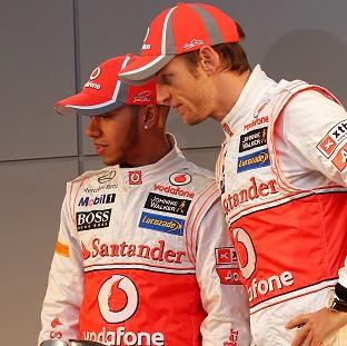 Jesnon Button, right, voiced his disappointment over Lewis Hamilton's, left, tweet