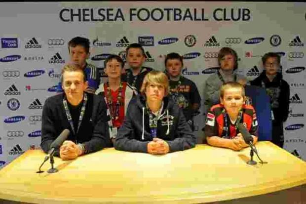 Mason McClelland back row, second from right) with friends in the Chelsea Press Box.