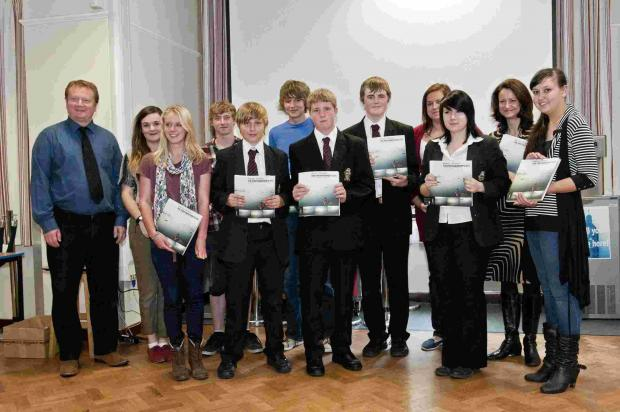 Students at Ringwood School with the photos they took for the Rotary Club calendar.
