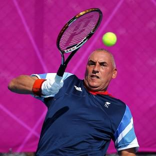 Peter Norfolk, pictured, and Andy Lapthorne were forced to settle for gold in the wheelchair tennis quad doubles