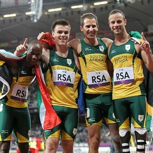 Oscar Pistorius, right, and his South Africa team-mates celebrate their victory in the relay