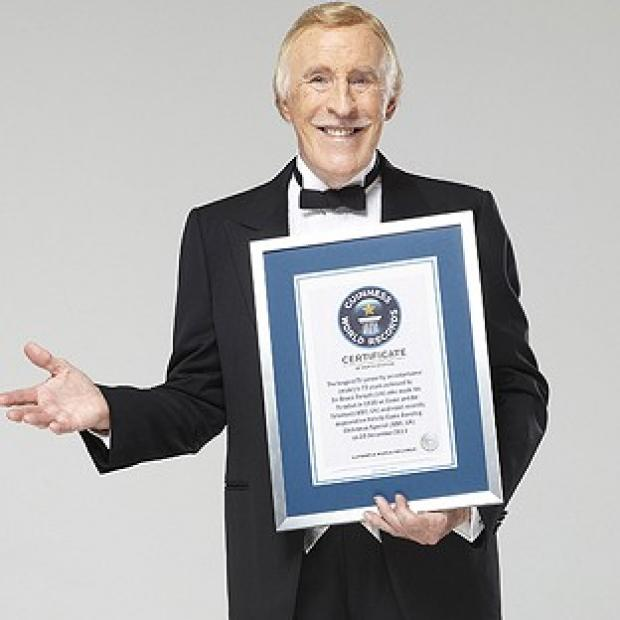 Sir Bruce Forsyth shows off his Guinness World Records certificate after being acknowledged for his long career (Guinness World Records/PA)