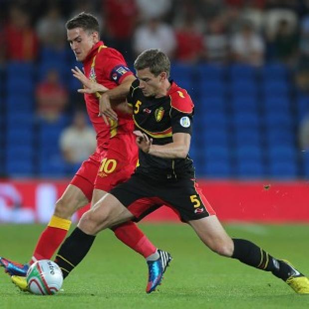 Aaron Ramsey, left, and Jan Vertonghen fight for the ball during Wales' loss to Belguim