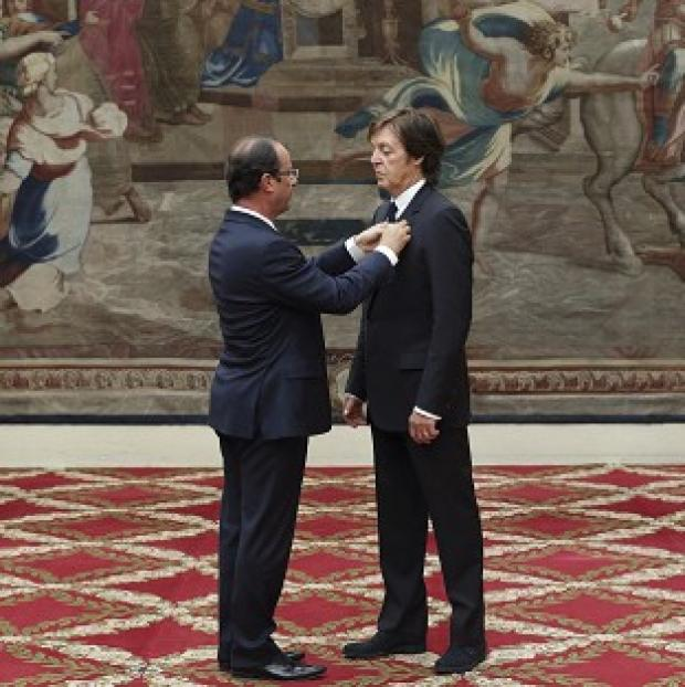 Sir Paul McCartney, right, is awarded the Legion of Honour by the French president