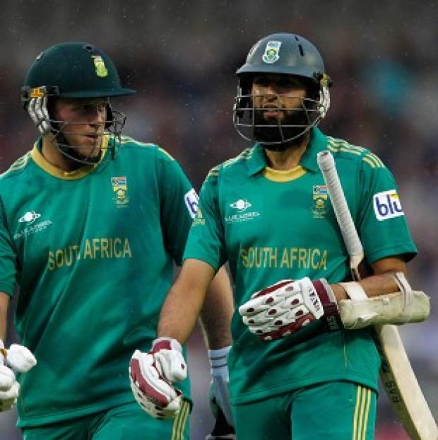 Hashim Amla, right, hit an unbeaten 47 as South Africa finished 77-5 in a match reduced to nine overs per side
