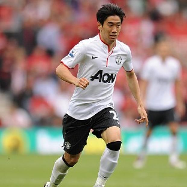 Manchester United's Shinji Kagawa sat out Japan's win over Iraq with a back injury
