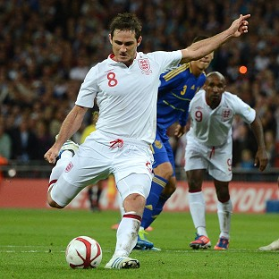 England's Frank Lampard rescued a point with a late penalty against Ukraine