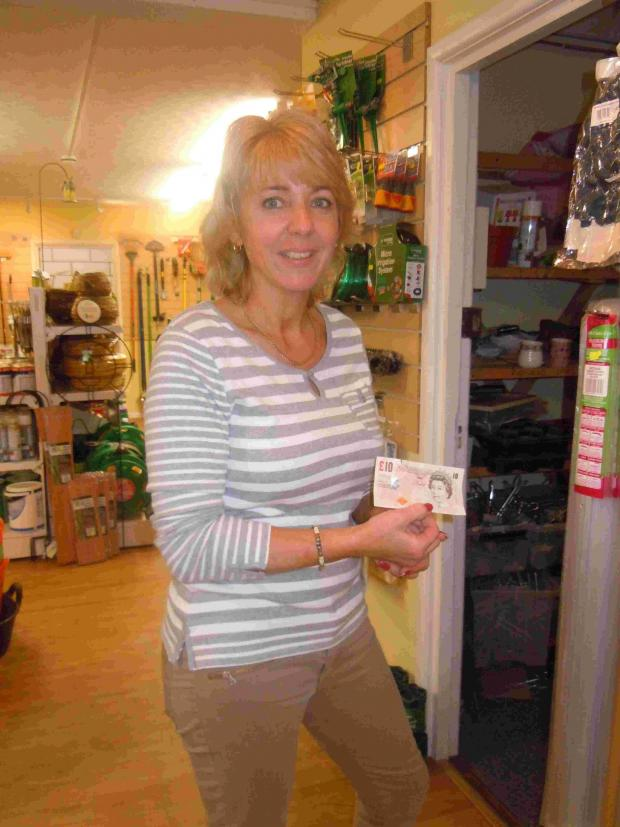 Nicky Wood of Ringwood Surplus Stores and a counterfeit £20 note.